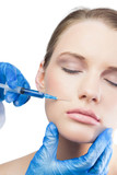 Relaxed gorgeous model having botox injection above the lips