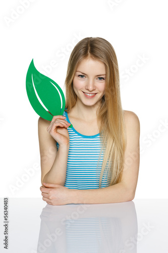 Young female holding eco symbol leaf