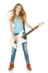 Pretty blond woman playing the guitar in full length