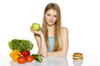 Woman choosing between healthy food and fast food