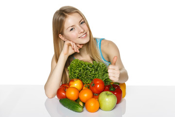 Girl with vegetables and fruits showing thumb up
