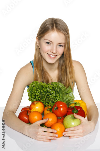 Girl embracing vegetables and fruits