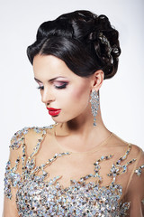 Formal Party. Fashion Model in Formal Shiny Dress with Jewels