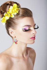 Glam. Fashionable Woman with Amazing Fantastic Eye Make-up