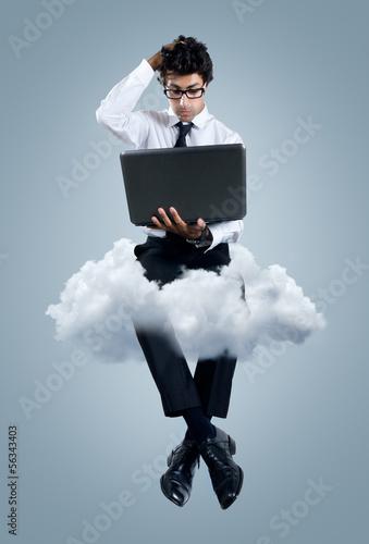 Businessman having problems with cloud computing technology