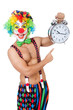 Clown with alarm clock on white