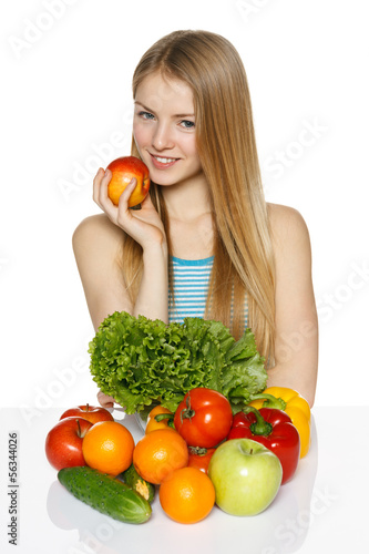 Woman sitting at the table with vegetables