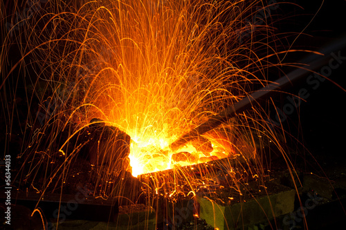 Sparks from coal in a forge - 56344033
