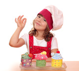 little girl cook with cupcakes and ok hand sign