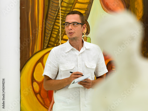 art collector at exhibition opening