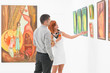 couple talking about an artwork in a gallery