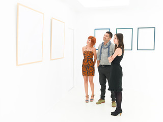 group of tourists contemplating artworks