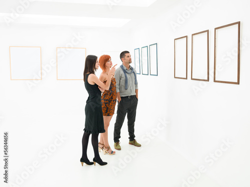 group of people contemplating artworks