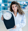 Doctor holding a weight scale