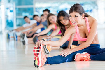 People at the gym stretching
