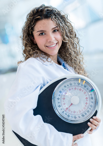 Nutritionist with a weight scale