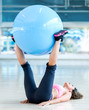 Woman exercising with a Swiss ball