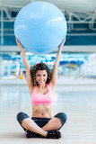 Gym woman with fitness ball