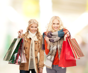 women in winter clothes with shopping bags