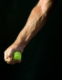 man's hand squeezing tennis ball