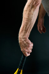 man's arm with tennis racket