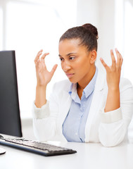stressed african woman with computer