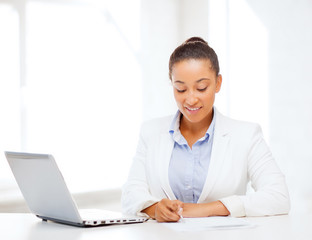 african businesswoman writing something