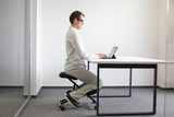 correct sitting position at desk wh tablet on kneeling chair