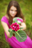 woman with pink flower