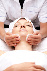 Woman is having cosmetic treatment at spa salon.