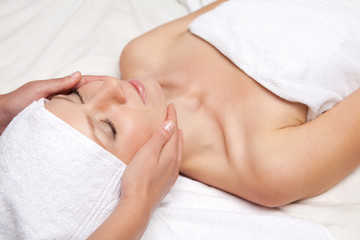 Woman getting massaging treatment over white background