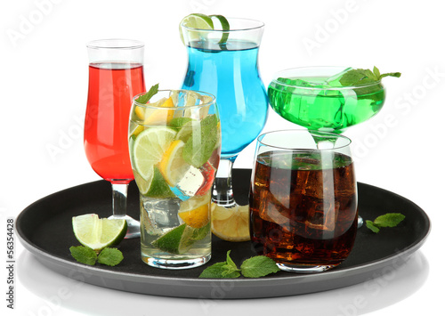 Many glasses of cocktails on tray, isolated on white