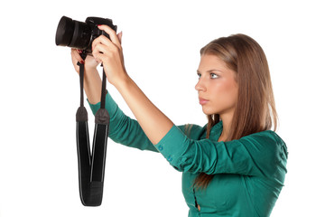 young girl photographing with her camera using LiveView
