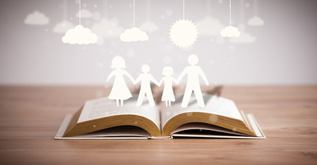 Cardboard figures of the family on opened book