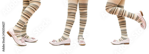 Set of child feet with stockings and shoes