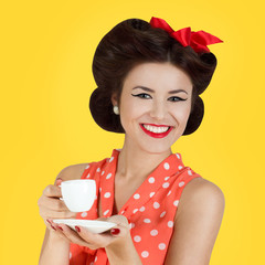 Pin-up style girl with cup of coffee
