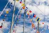 Colourful signal flags on a sailing boat