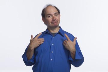 Man making a gesture at himself, horizontal