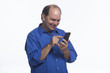 Man texting on his smartphone, horizontal