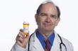 Doctor holding prescription bottle, horizontal