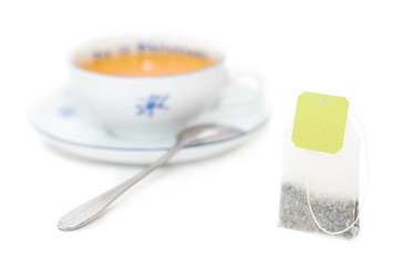 Tea bag  with  cup of tea