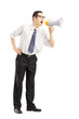 Angry businessman shouting via megaphone