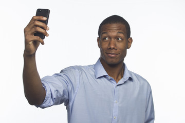 Young man taking a picture of himself, horizontal