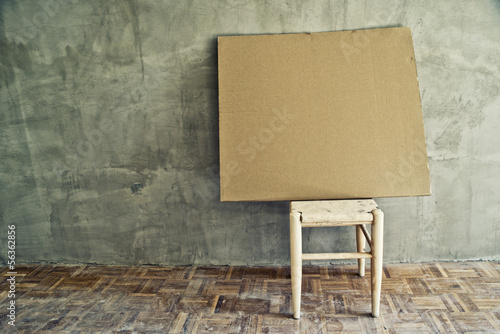 Old vintage chair and empty cardboard