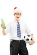 Smiling male with santa hat holding a beer bottle and ball