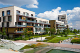 Fototapety View of public park with newly built modern block of flats