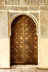 A door decorated in arabic style in La Alhambra, Granada, Spain.