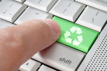 Business concept male finger pressing Recycle key