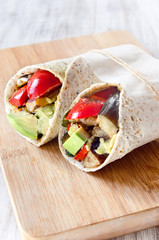 Healthy burrito wraps with roasted vegetables