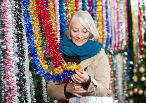 Woman Shopping For Tinsels At Christmas Store